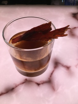 "Archetype's ""New Fangled,"" served with smoked vodka, tea syrup, bitters and a jerky topping."